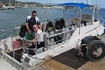 Assisting handicapped diver onto the boat